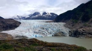 a tidewater glacier with ocean in the foreground