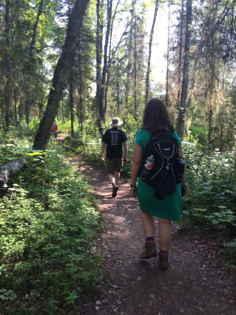 Husband and wife walking along a trail