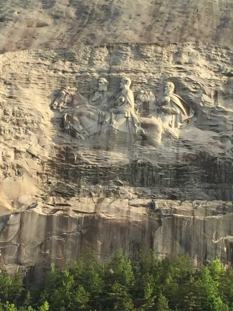 carving in a stone mountain of 3 generals on horses