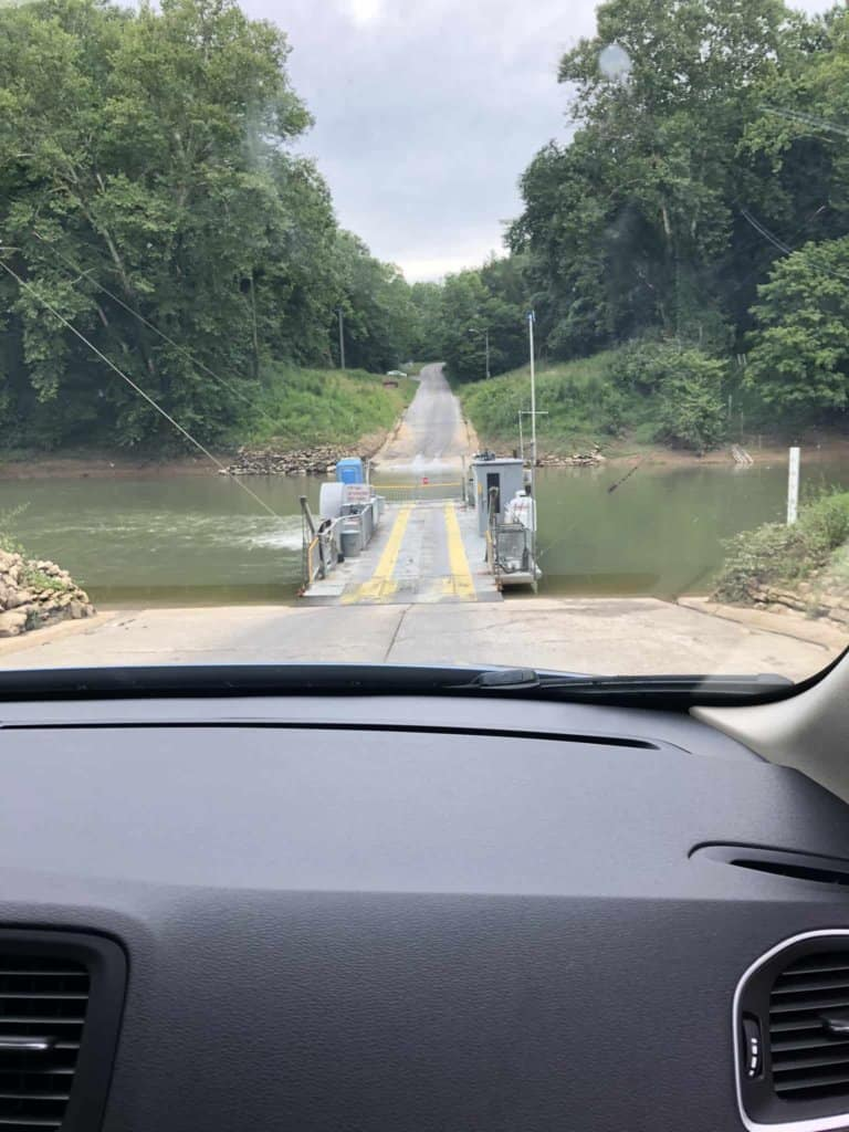 driving car onto river ferry