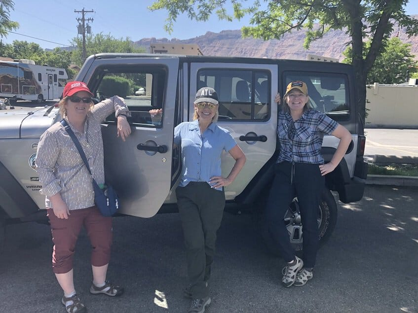 Girls in front of jeep