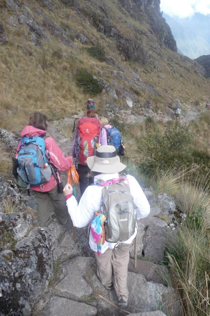 Hiking down steps on the Inca Trail to Machu Picchu